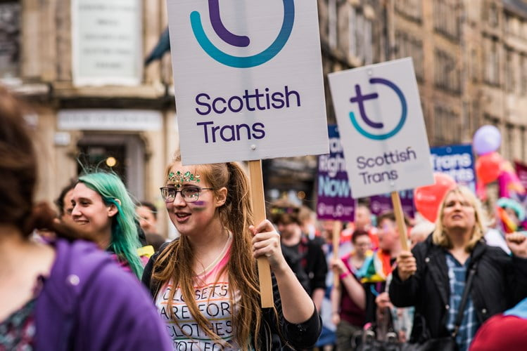Scottish Trans placards being carried on Pride Edinburgh march