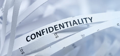 "Shredded paper with just the word ""confidentiality"" showing"